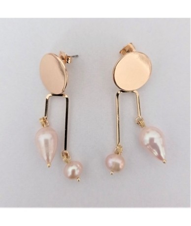 Handmade earrings with fresh baroque water pearls and gold-plated elements, by Anne L Or London.